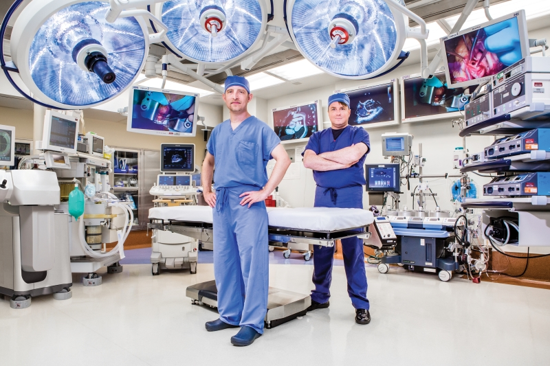 Doctors Kulik and Cartledge standing together in the operating room